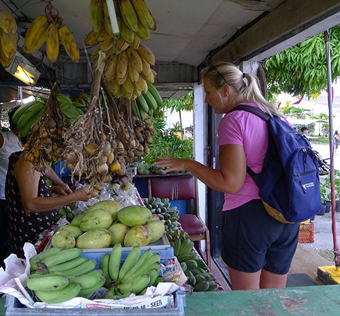 Jeannie, from Team Hawaii, shops locally for bananas.