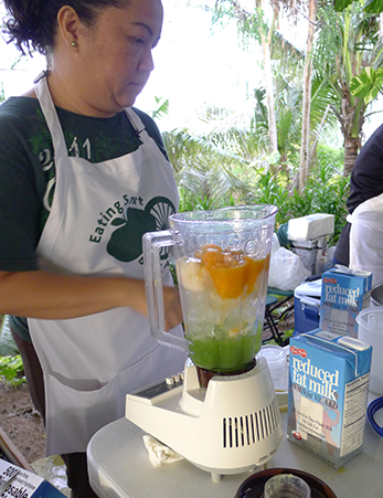 University of Guam Extension Agent gets ready to blend a healthy fruit smoothy.