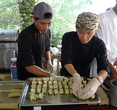 Guam Community College chefs-in-training prepare a healthy wrap.
