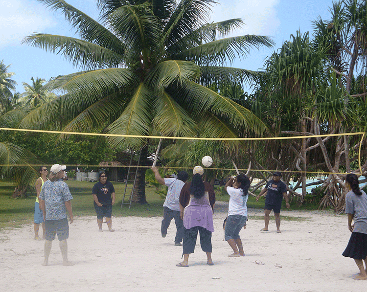 The FAS team getting active with a pick-up volleyball game on Eneko Islet in the RMI.
