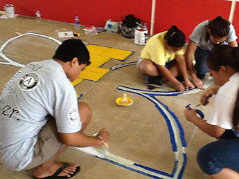 Volunteers working together to complete their task.