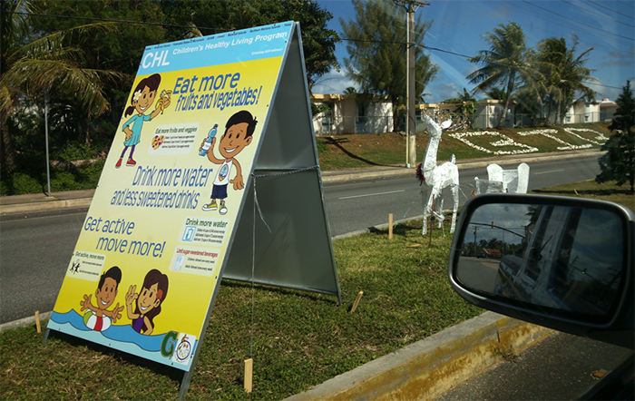 CHL sandwich board displays the six target behaviors in the village of Yona.  The sign will be rotated throughout the intervention villages.